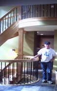 Lynn Seely, standing by upper & Ground Level Stairs withcurved handrailings.