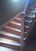 Natural wood basement stairs