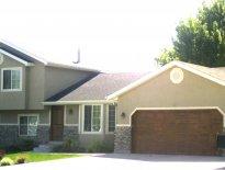 Full View Of Home With Woodgrained Walnut Exterior Door And Matching Garage  Door