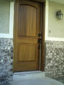 Side view of woodgrained walnut front door