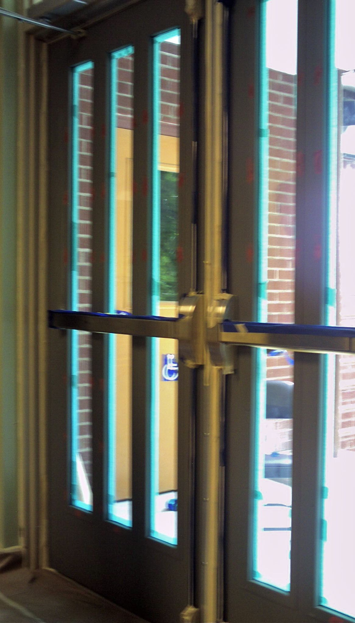 Masking the new interior metal doors of the First Presbyterian Church. & commercial interior metal doors wood grained doors church metal ...