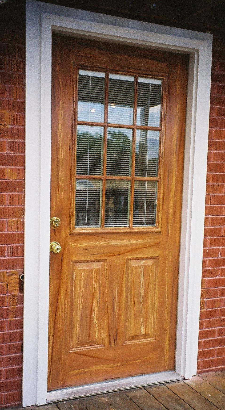 Doors woodgrained match the wood deck and brick. & Exterior Metall Deck Door
