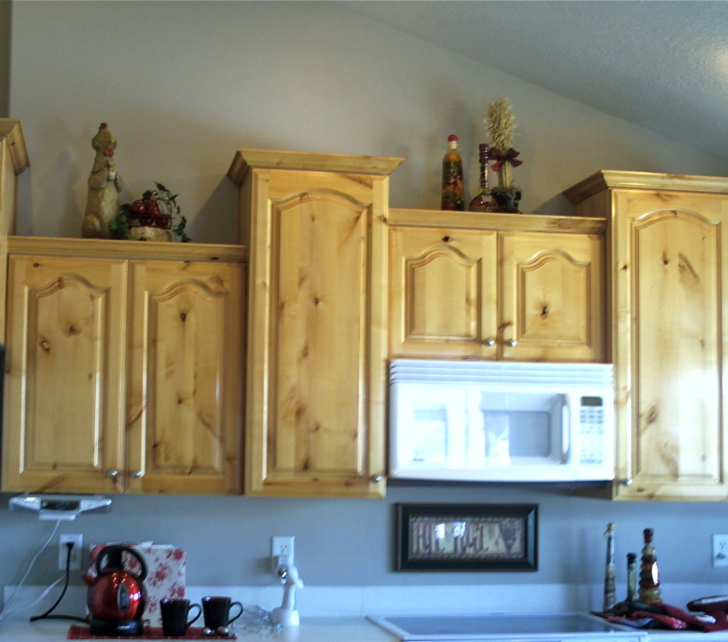 View Of Knotty Alderwood Kitchen Cupboards When The Finish Yellowed.