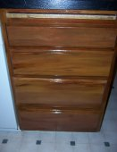 Repaired and refurbished kitchen cabinet drawers