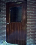 Woodgrained metal utility door at First Presbyterian Church in Logan Utah