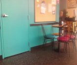 This pictures shows the finished blue wall with chairs and table in front of it.