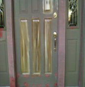 This metal door and wood casing had extensive damage that was repairred and covered with Bondo.