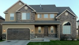 This picture shows the Saratoga finished faux finished wood grained metal garage and fiberglass entry door.