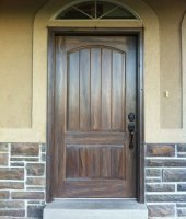 exterior fiberglass doors that have been wood grained or faux