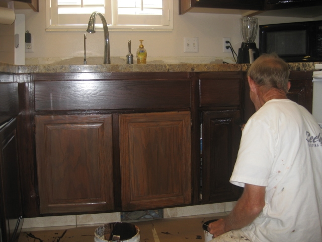 Awesome ... An Artist At Work Applied Undercoat To Refurbish Oak Cabinets