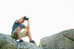 Outdoorsman Using Binoculars and Eye Shields