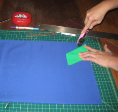 using your rotary blade and pattern cut all of the pieces needed to sew your clutch
