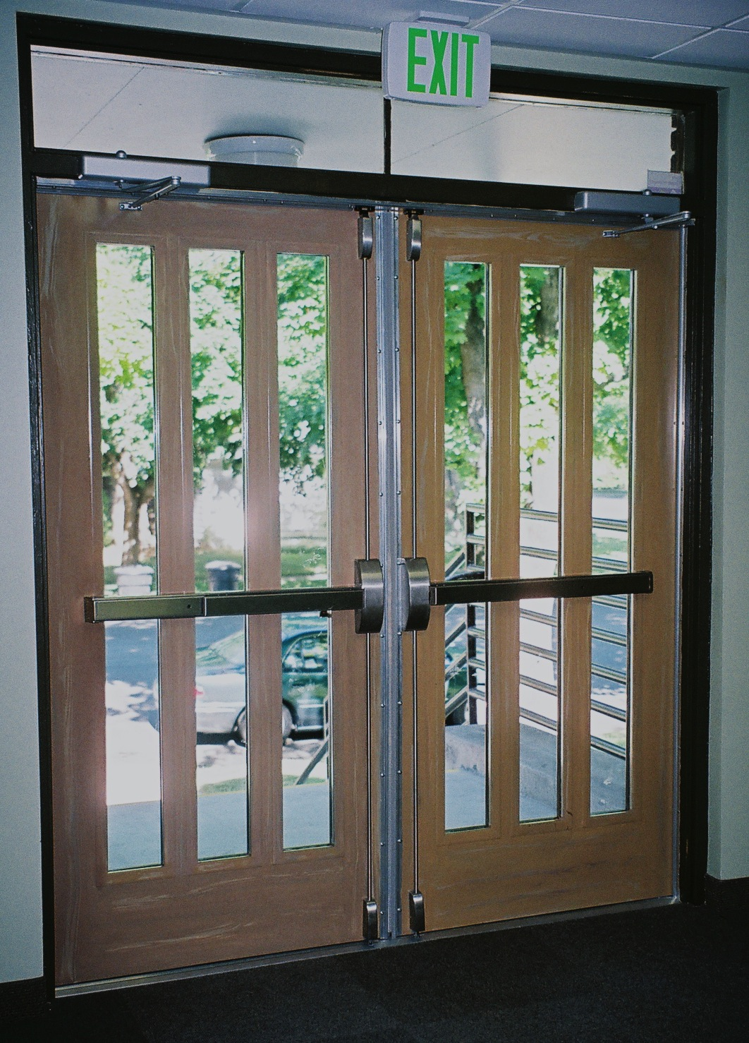 commercial interior metal doors, wood grained doors, church metal doors.