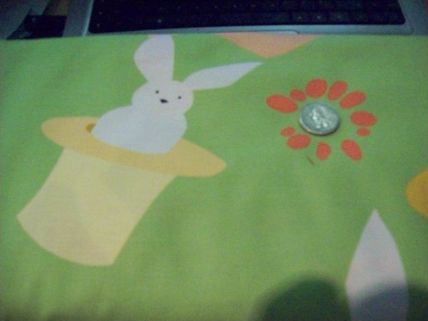 Fabric Cotton MAGIC RABBITS ON GREEN BACKGROUND BY RUTH MCDOWELL #3212