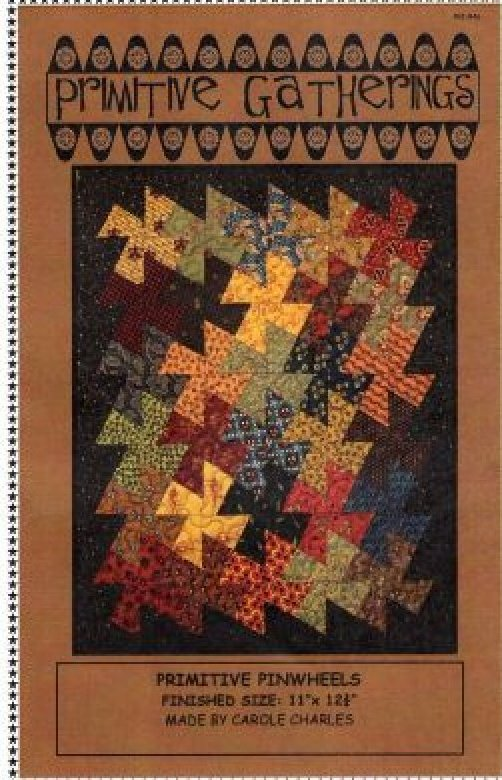 l quilt that is 11x12 3/4Primitive Pinwheels twister with Primitive Gatherings pattern