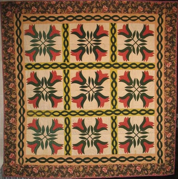 FOUR TULIPS ANTIQUE QUILT, chintz border