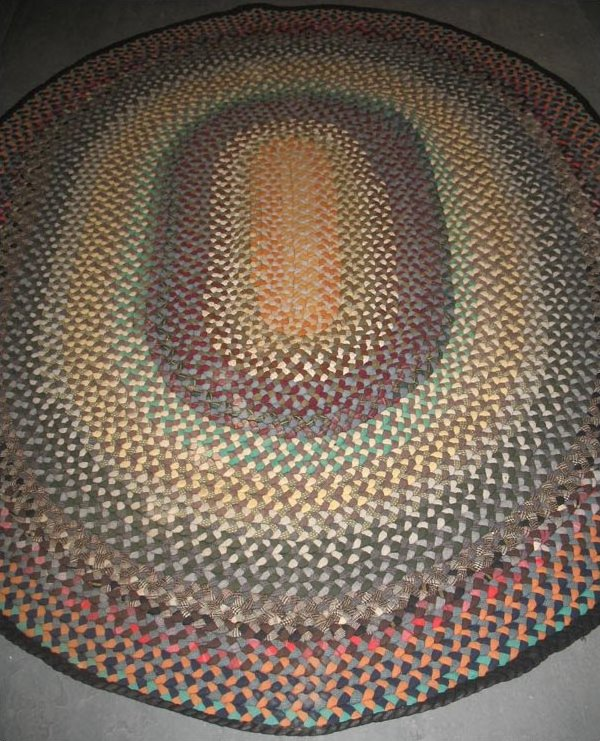 BRAIDED OVAL ANTIQUE RUG with wide bands of color