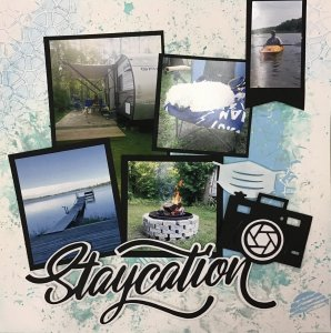 Photo of the Staycation Scrapbooking layout. Blue inked designed with photos, a cut out title and camera and mask designs