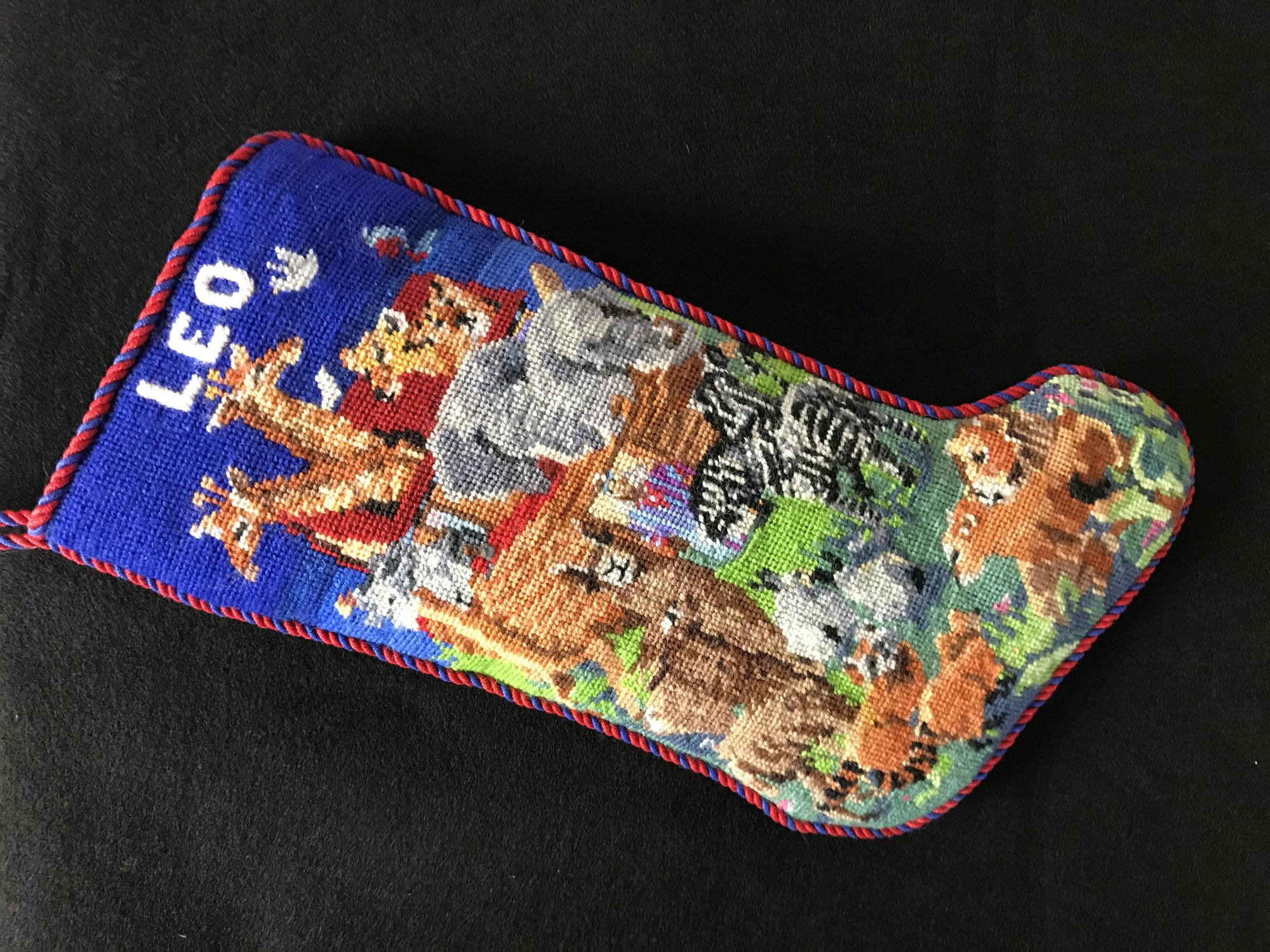Leo Stocking - Stitched by Sharon H.