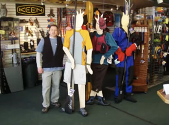 employee in kayak shop