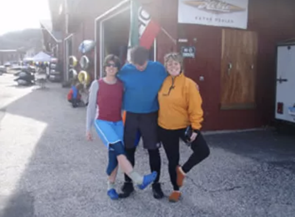employees outside canoe and kayak shop