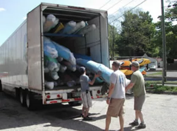 employees unloading kayaks