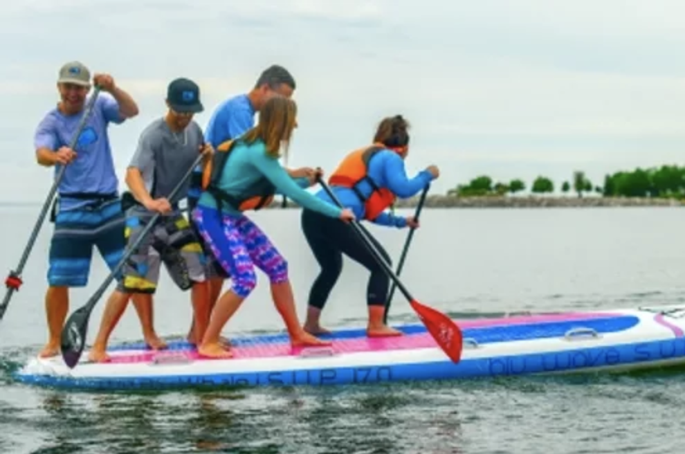 group on large paddle board