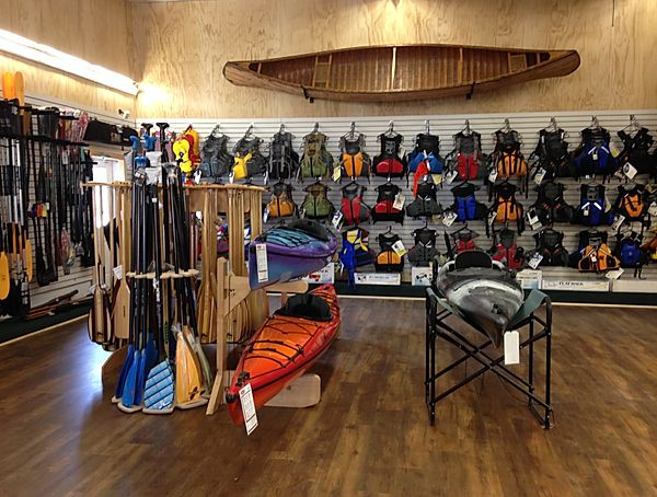 life jackets and kayak and canoe paddles