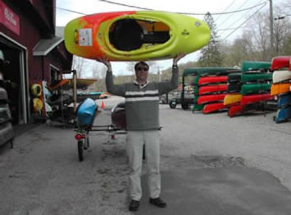 man with whitewater kayak