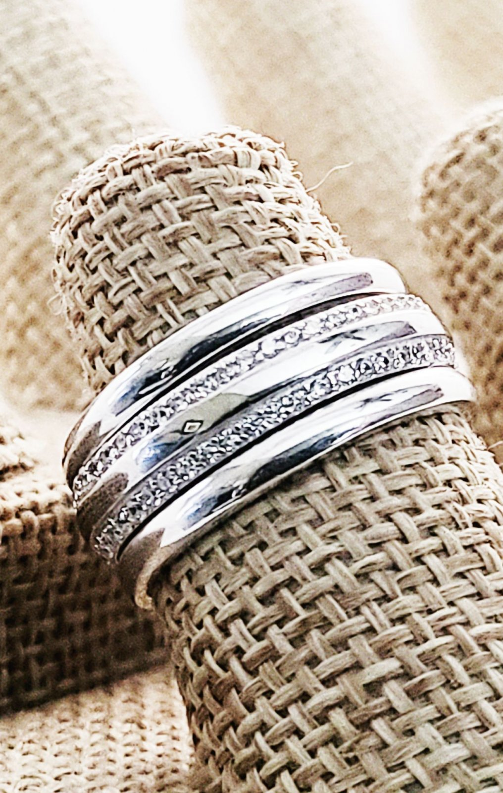 Two Sterling Silver Simple Bands with a Milgrain Stone Channel set Center