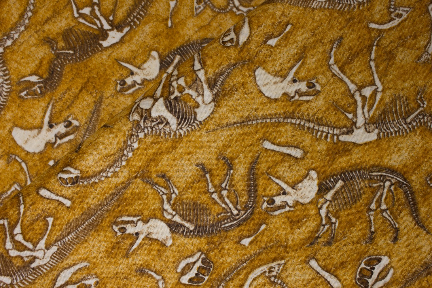Dinosaur Bones on Tan:  Jurassic Jungle by Dan Morris for Quilting Treasures