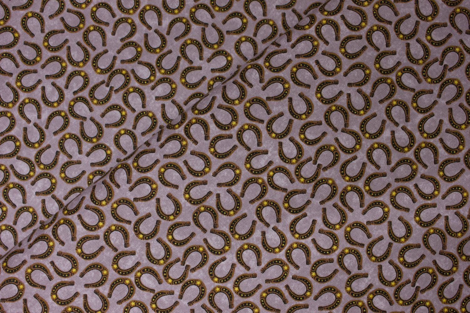 Horsehoes on Taupe: Horseplay by Oasis Fabrics