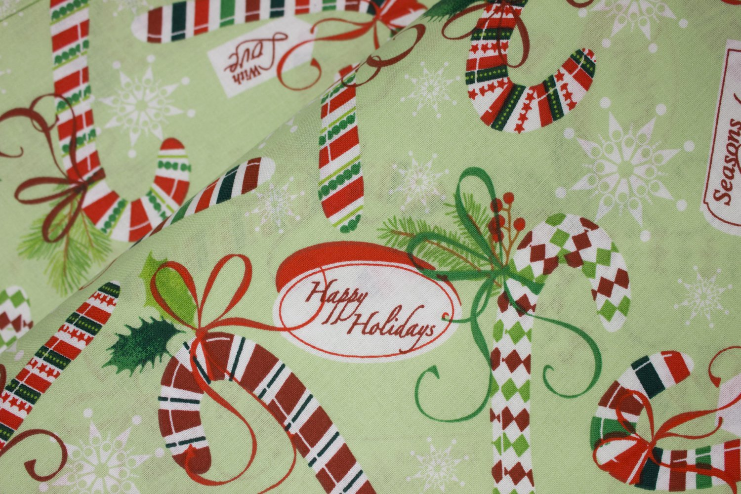 Red, White, and Green Candy Canes with Tags on Light Green