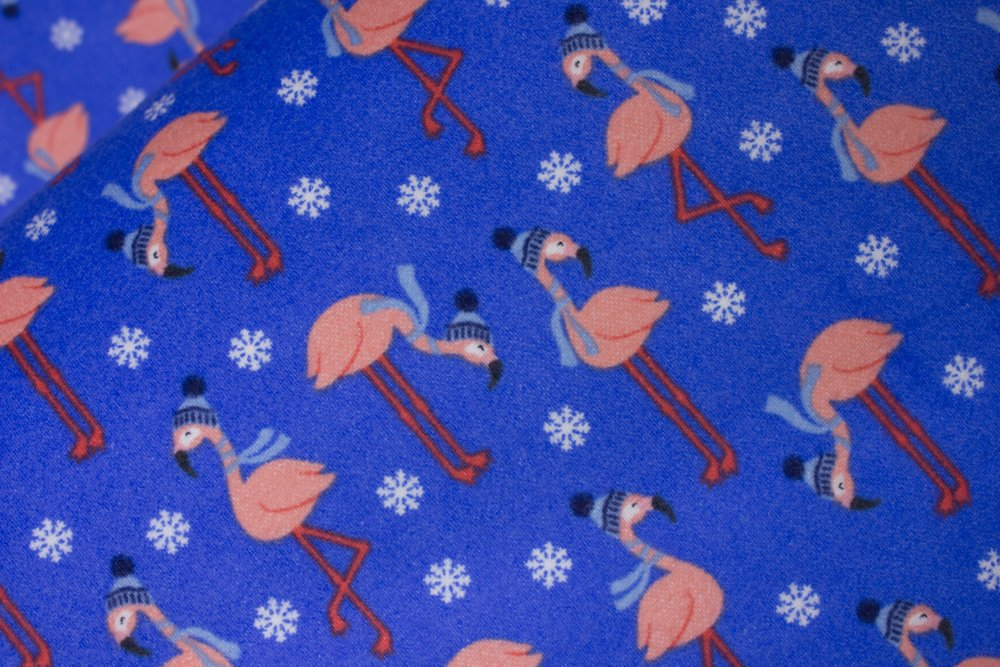 Flannel: Pink Flamingos wearing Light Blue Hats and Scarves on Blue with White Snowflakes:  Bundled Buddies by Andie Hanna for Robert Kaufman