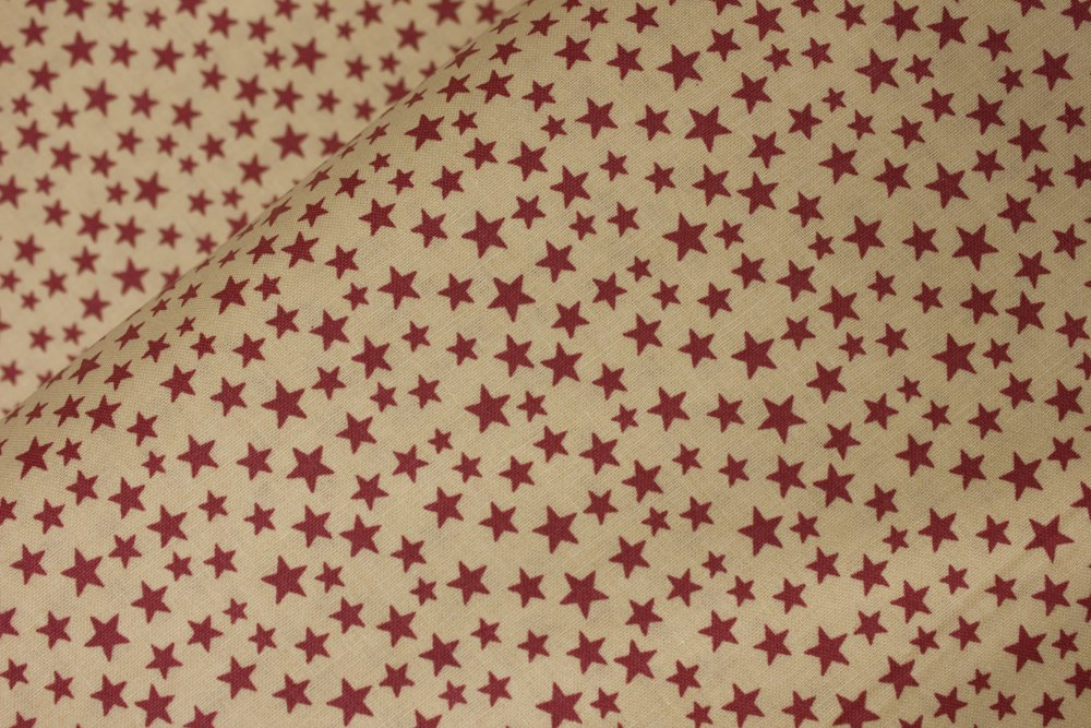 Random Red Stars on Light Tan