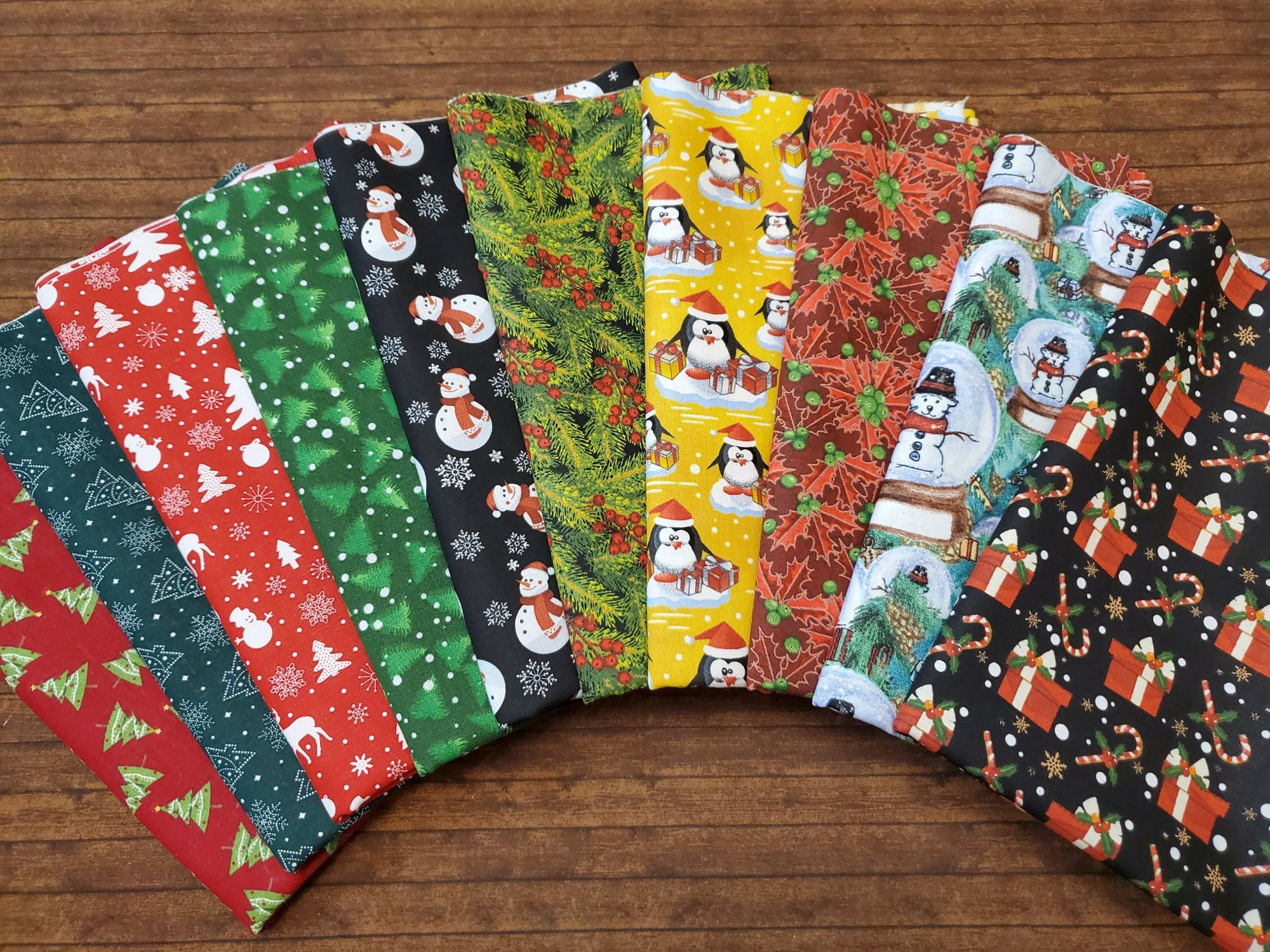 Classically Christmas - Traditional Christmas Themes - 10  Piece Half Yard Bundle Pack snowmen, presents, Christmas trees, holly, pine trees, poinsettias