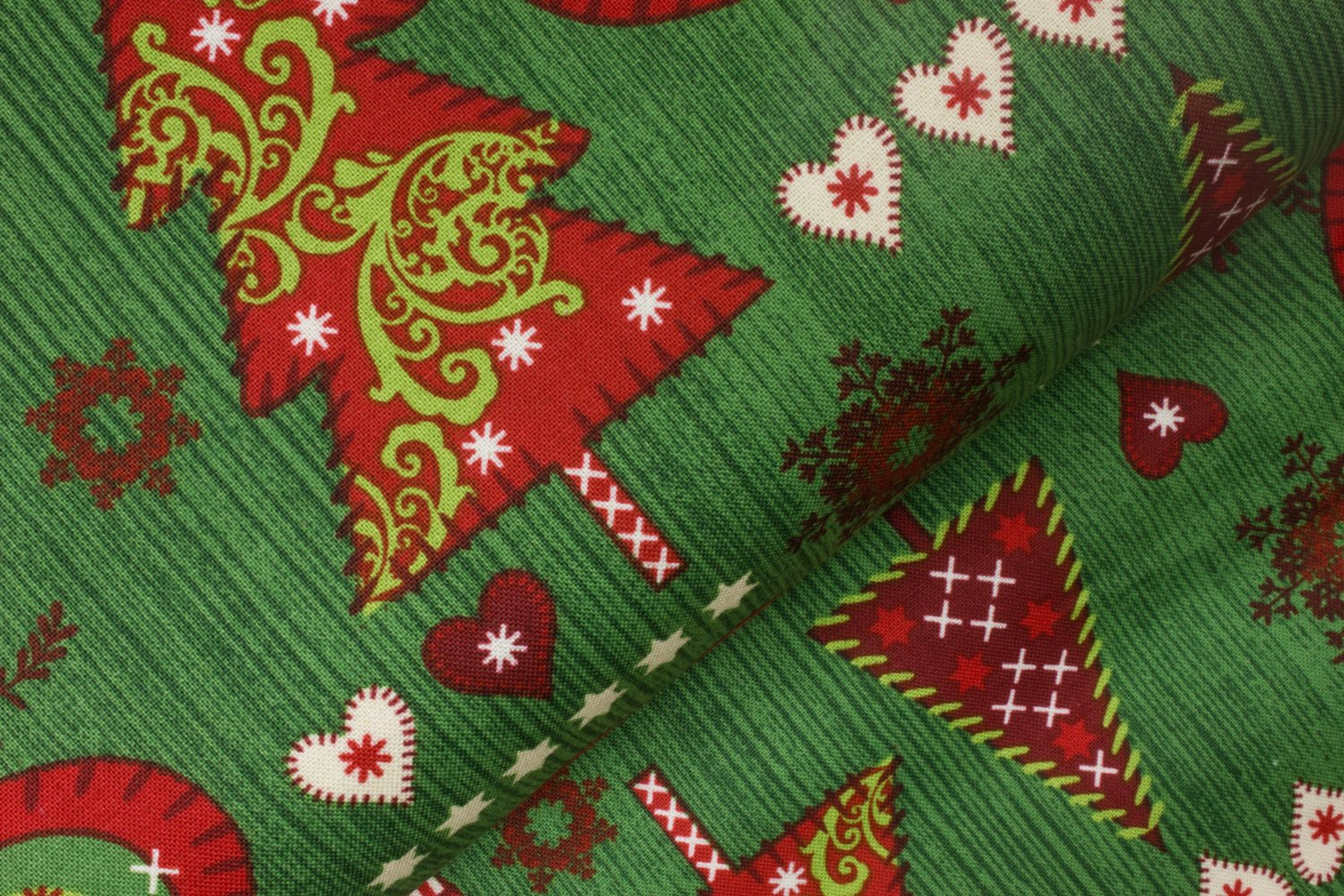 Stitched Christmas Trees, Hearts, and Ornaments on Green by R.E.D. International Textiles - Fabricland
