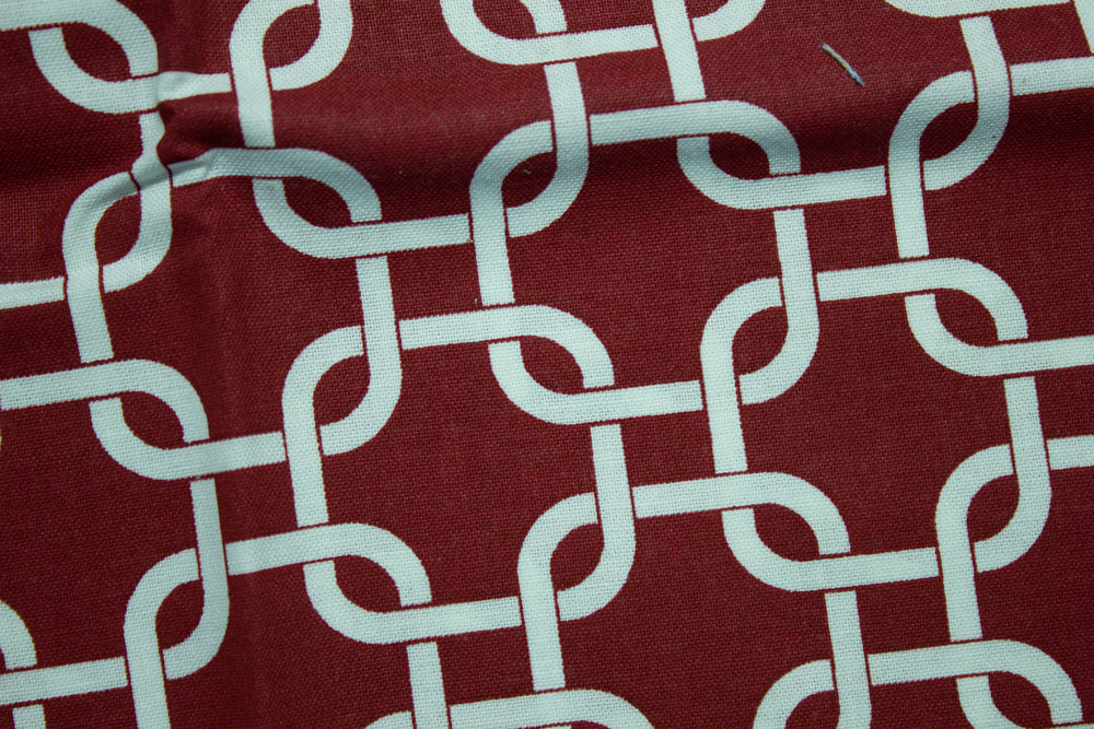 Interlocking Links on Burgundy - Single Fat Quarter