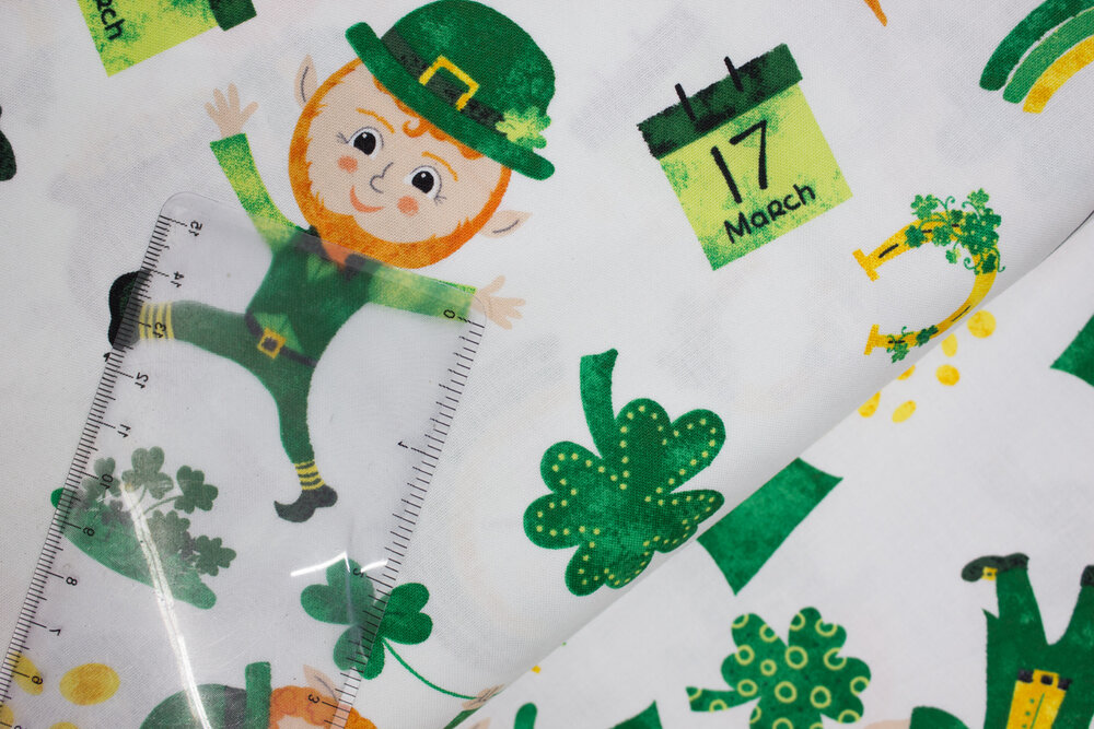 SPECIALTY FABRICS:  Tossed Leprechauns with Clovers, Horseshoes, Pots of Gold, March 17 on White:  Spring Jubilee by Alyssa Kays for Blank Quilting