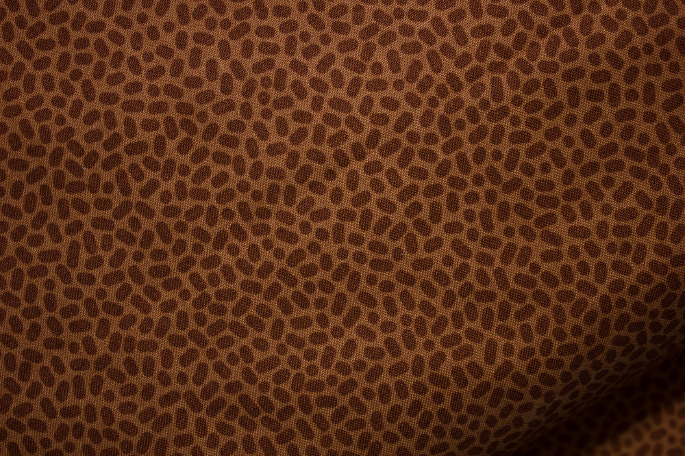 Speckles: Rust Ovals on Rust Background for Patrick Lose Fabrics