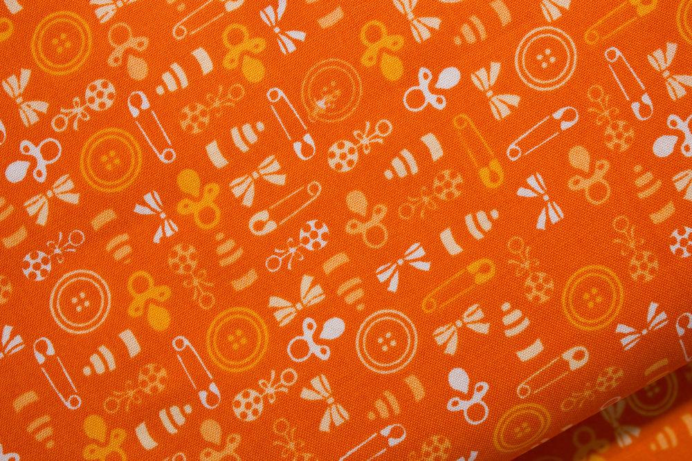 Baby Talk: Orange Pacifiers and Rattles on Orange