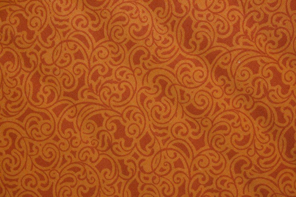 Orange Swirls on Tangerine by EBI Fabrics