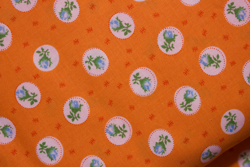 Orange with Blue Flowers in White Circles: First Blush for Windham Fabrics
