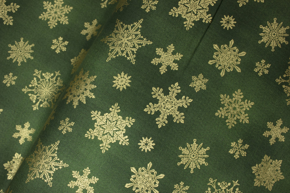 CAT-I-TUDE CHRISTMAS: Playful Flakes: Gold Metallic Snowflakes on Green - by Ann Lauer for Benartex