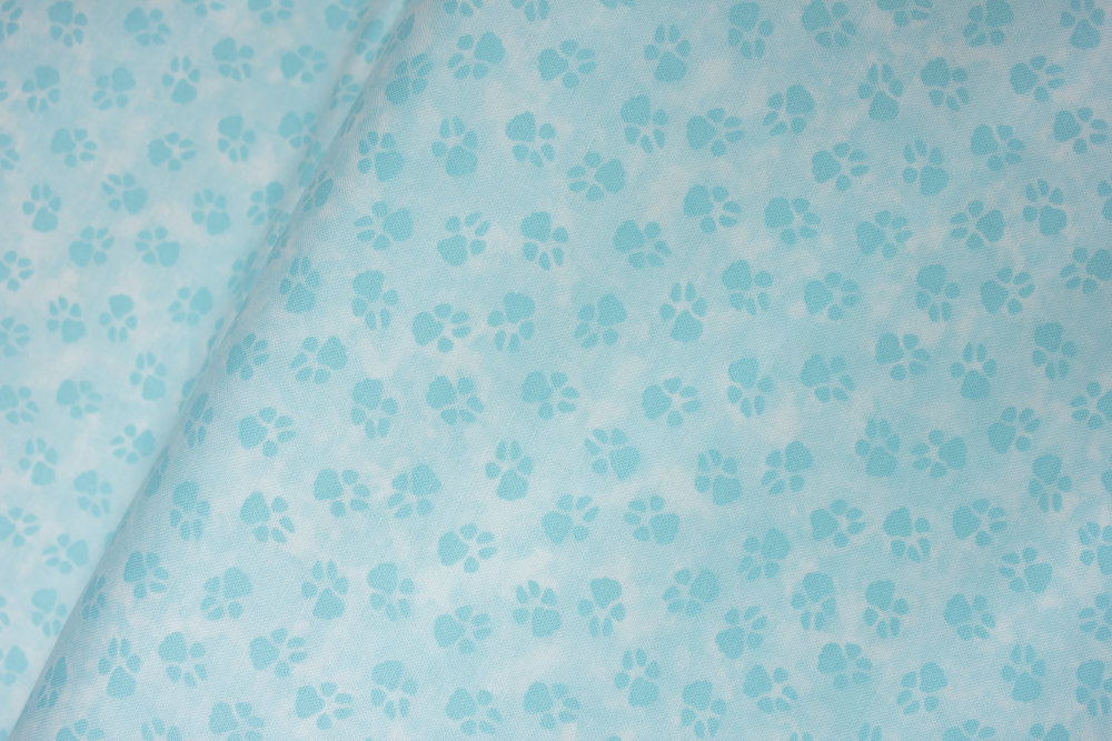 Dog-On-It: Blue Paw Prints on Light Blue by Ann Lauer for Benartex