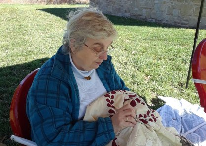 Owner Sharon hand quilting