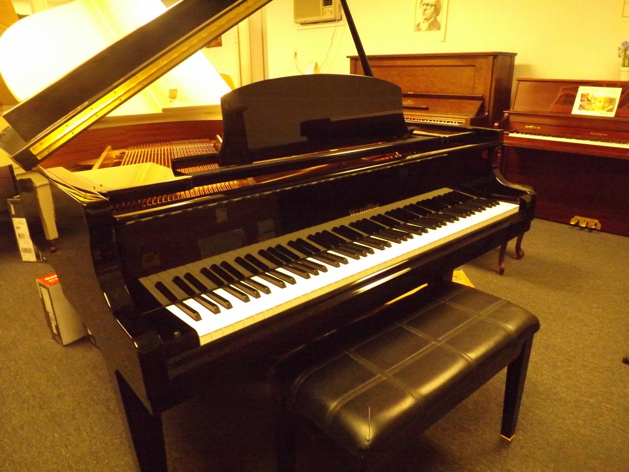 Wurlitzer Baby Grand Piano & Padded Bench