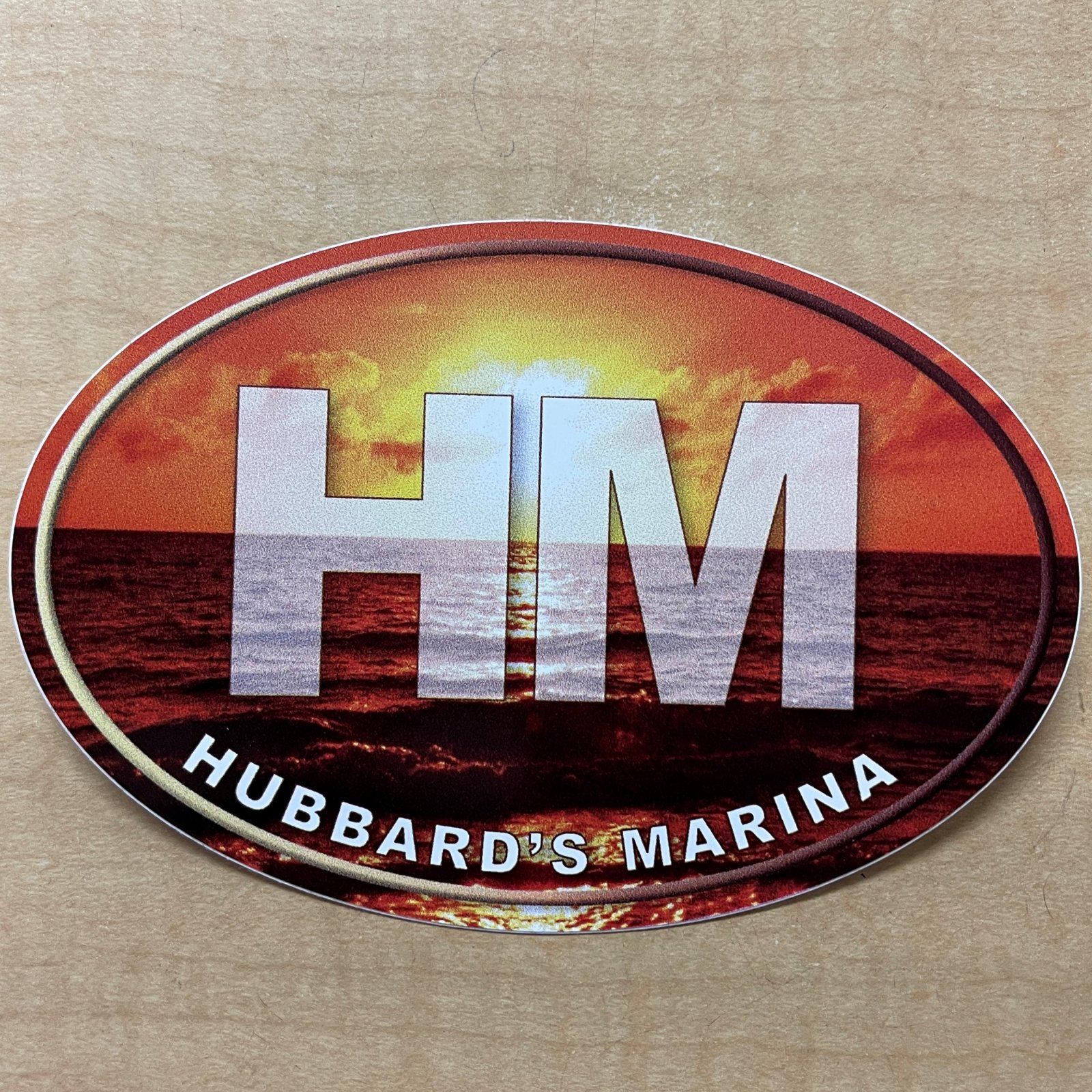 HM oval decal - Sunrise background with white HM (large)