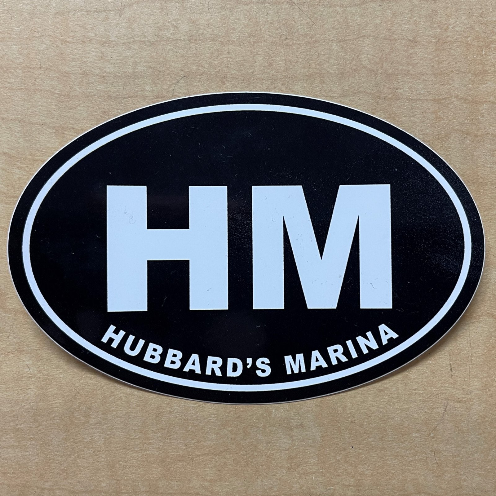 HM oval decal - black Background with white HM (small)