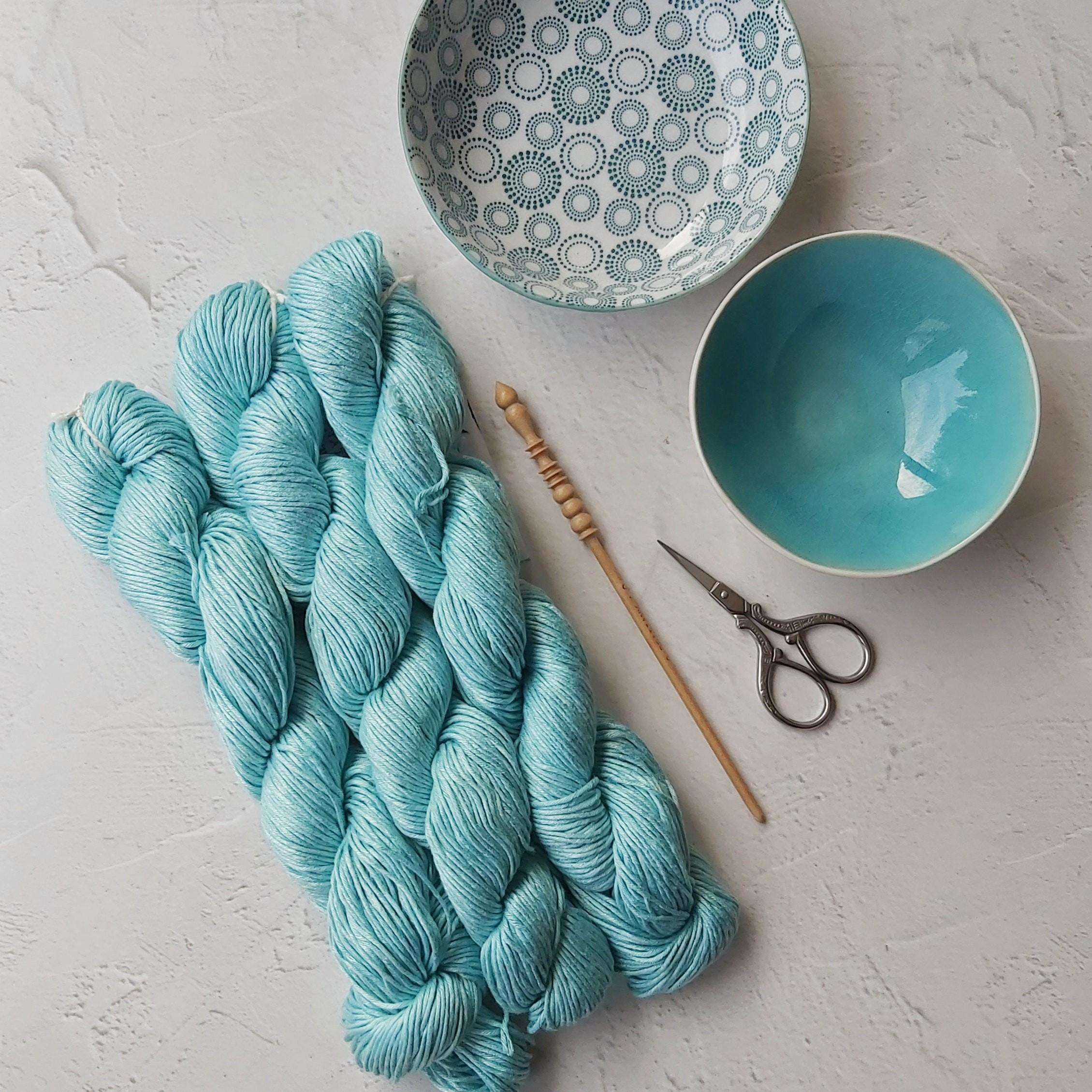 Blue yarn and needle